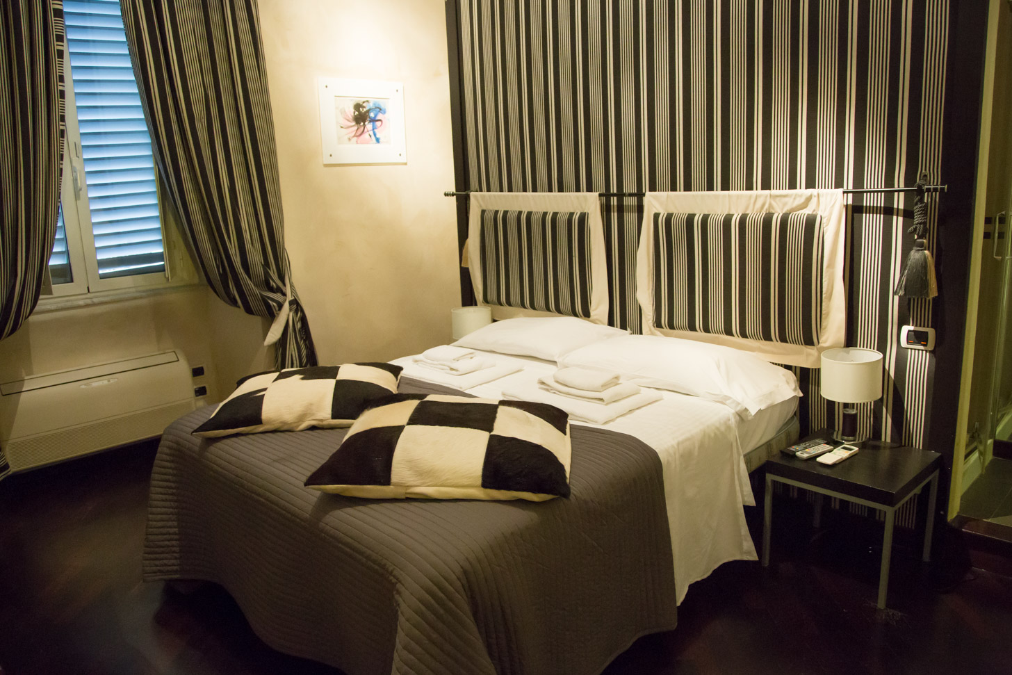 Een comfortabel bed in Rome.